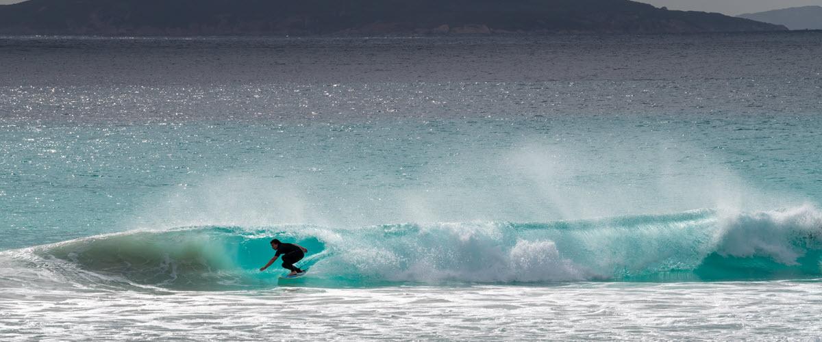 Surfer at Cape Le Grand Beach in Esperance WA.