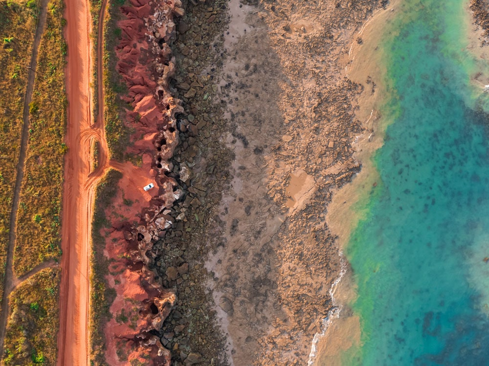 Aerial view of the red sands and turquoise waters off Gantheaume Beach, Broome.
