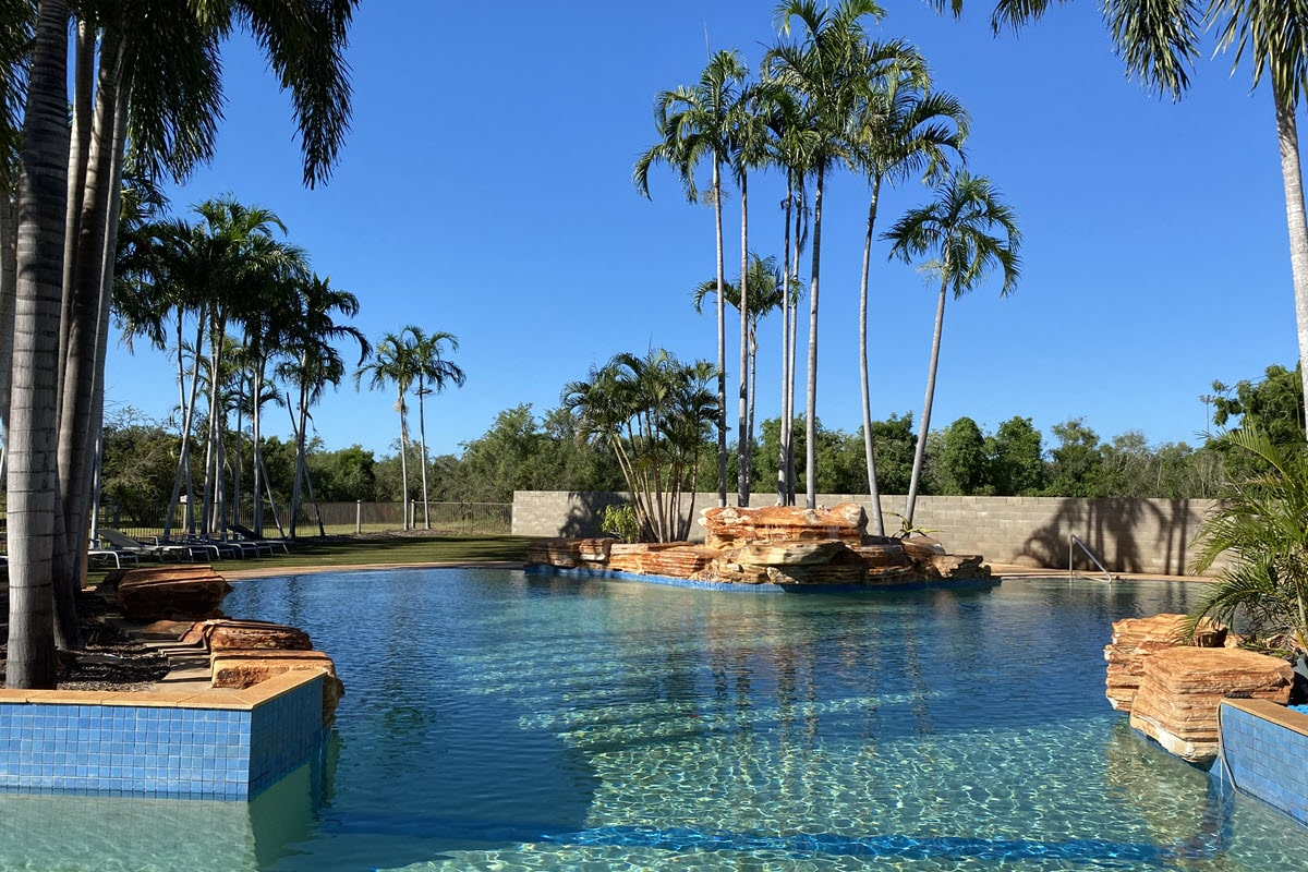Shot of pool and palm trees at Broome Caravan Park in WA's northern Kimberley region.