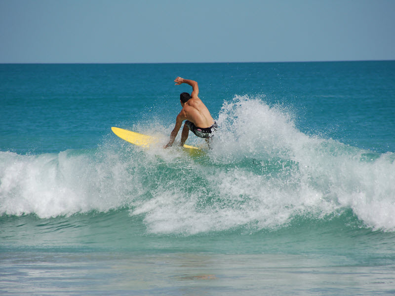 Man surfing a wave when looking for things to do in Broome, Western Australia.