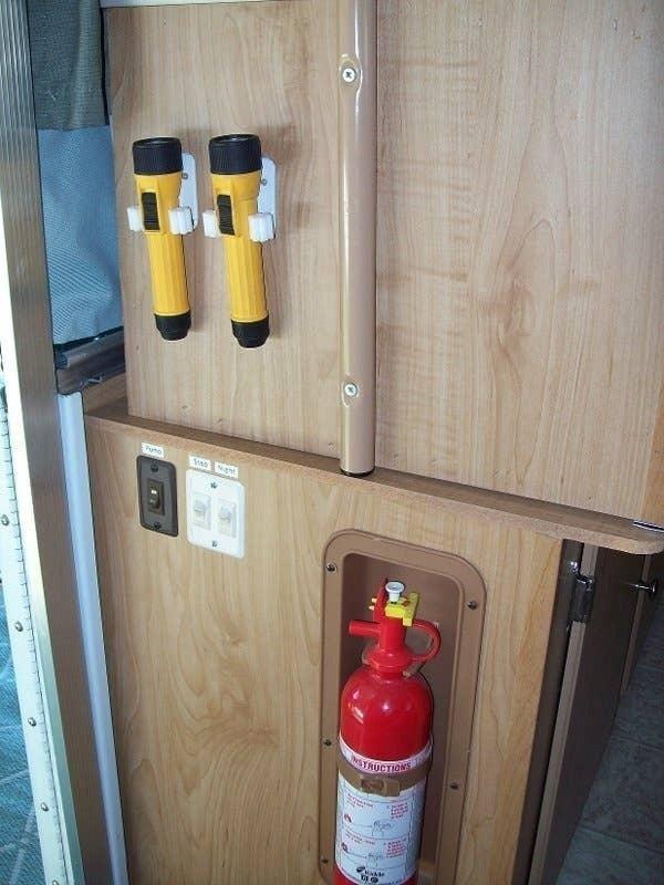 broom holder caravan cupboard storage ideas