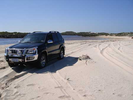 4wd on hill river mouth beach jurien bay