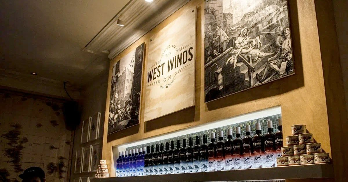 Behind the bar with logo of West Winds Gin in Western Australia's south west.