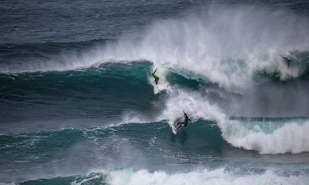 surfing a wave in margaret river
