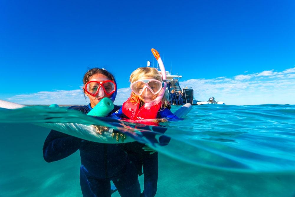 Teach the kids to snorkel at Ningaloo Marine Park, Western Australia.
