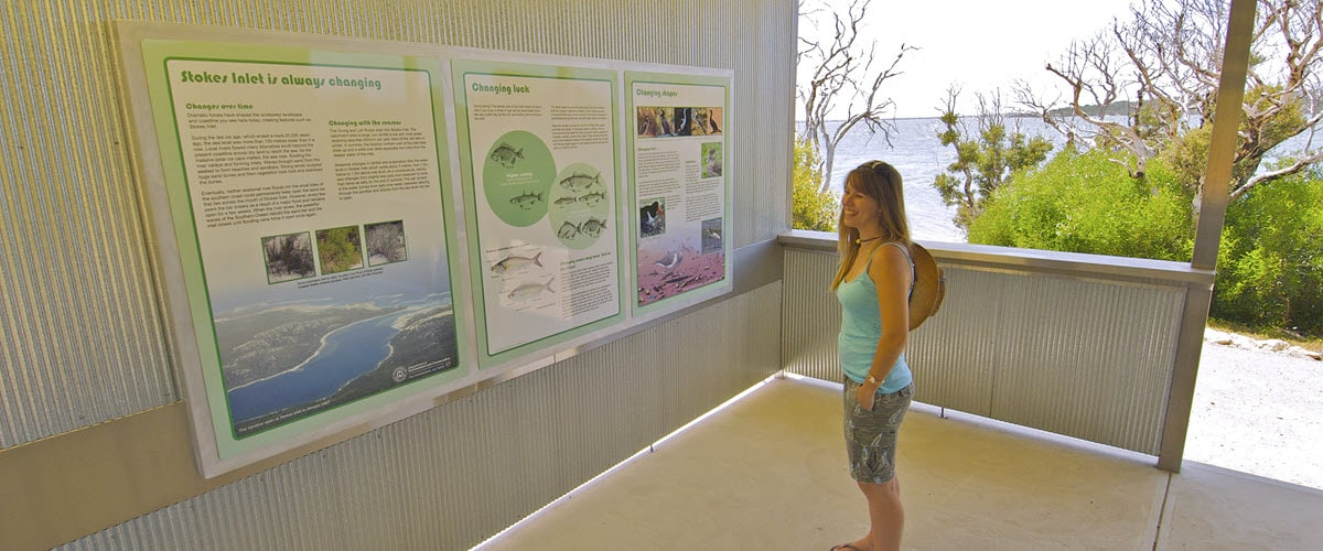 Woman reading info boards at Stokes National Park in Esperance, WA.