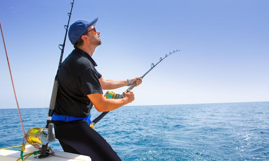 Man fishing off the shore at Shark Bay in Western Australia.