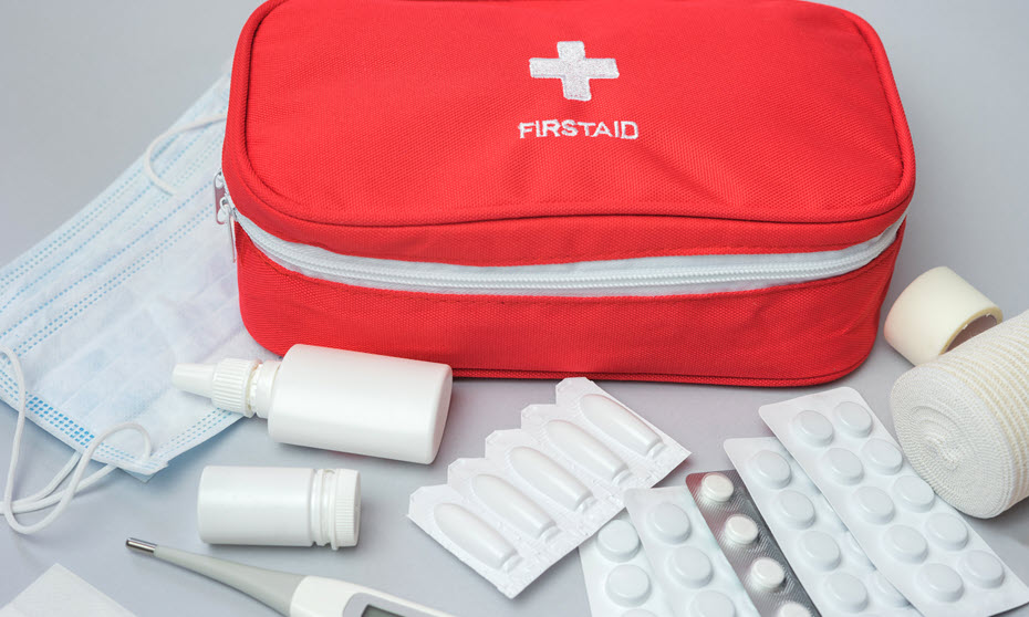 Medications within a first aid kit.