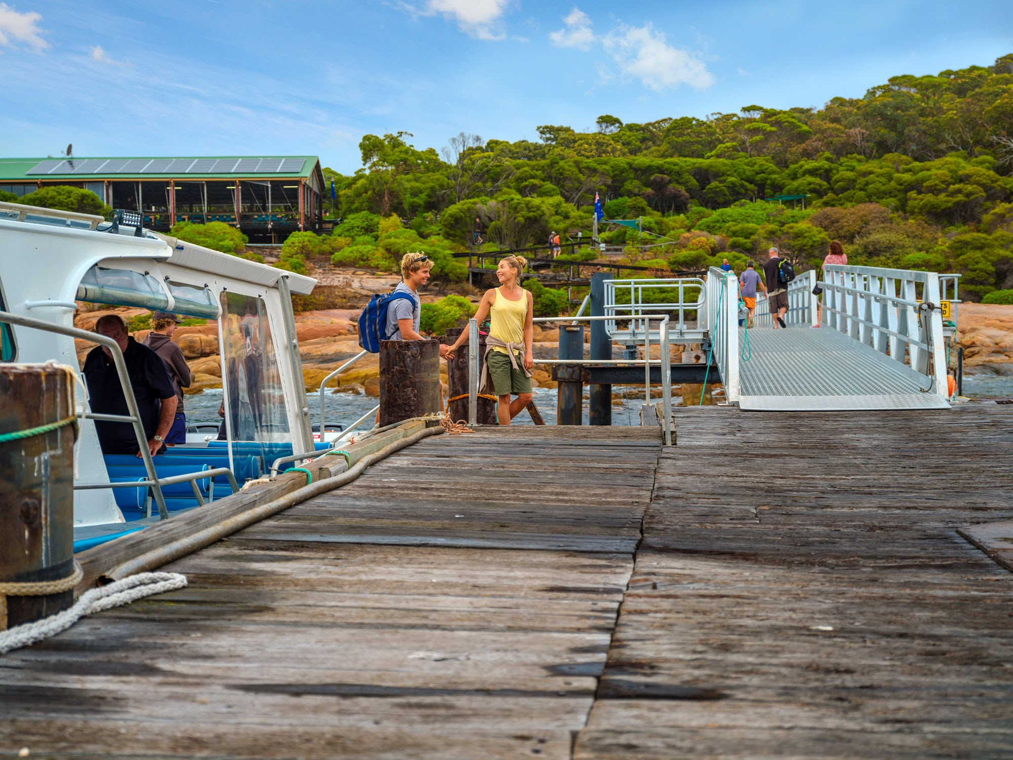Couple boarding a boat on Woody Island, Esperance.